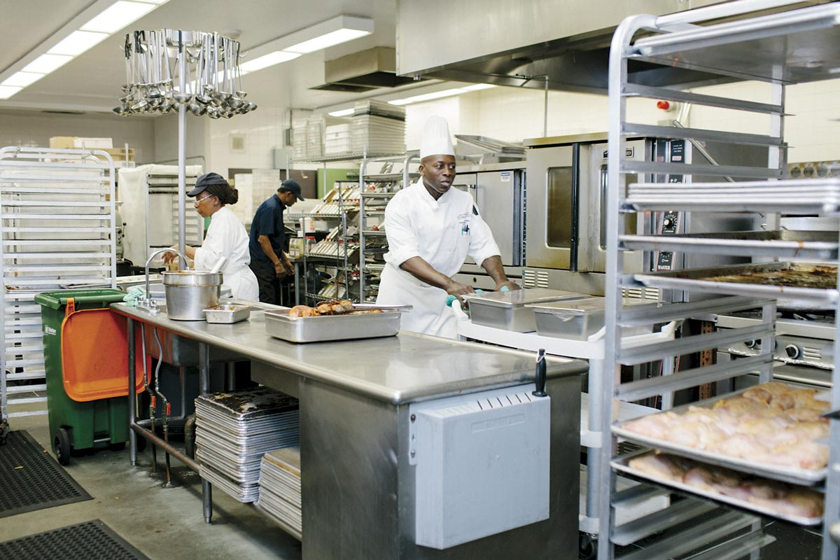 People at work within the large-scale kitchen at New College.